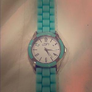 Bright, flexible aqua green watch